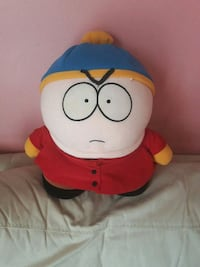 red and white plush toy 554 km