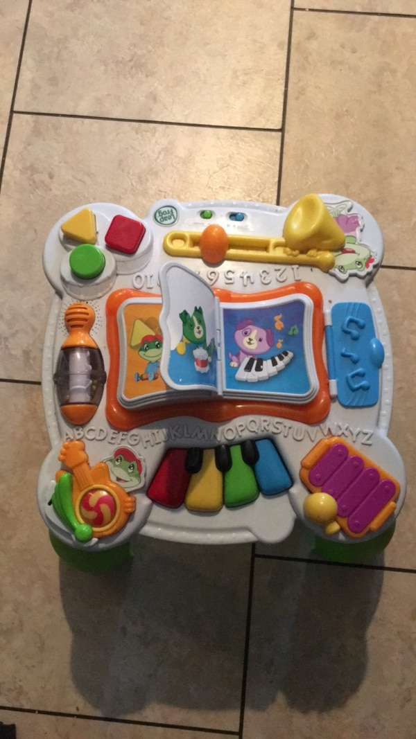 baby's white and multicolored activity table
