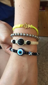 two black and white beaded bracelets