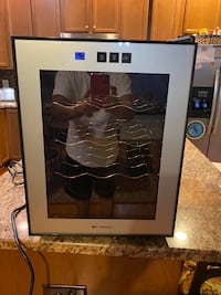 Wine cooler(Great quality and brand. Emerson 12 bottle capacity)