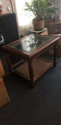 brown wooden framed glass top coffee table Cadillac, 49601
