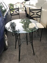 round black metal base glass top table Mississauga, L5A 3J4