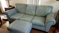 Blue leather couch with ottoma