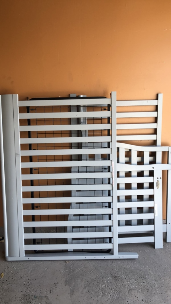 white wooden bed frame and bed frame
