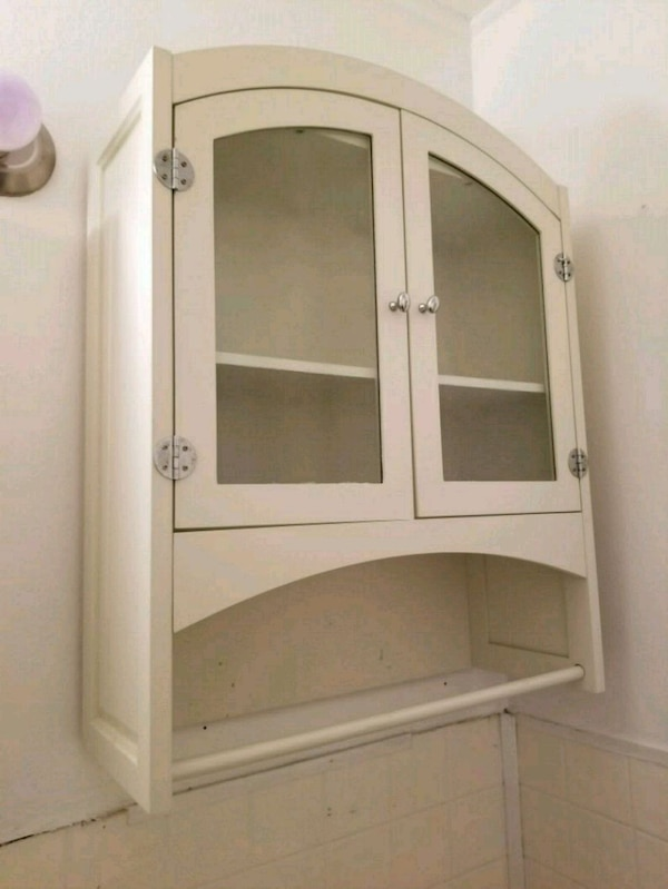 white wooden cabinet with glass doors