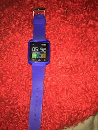 silver aluminum case Apple Watch with blue Sport Band 503 km