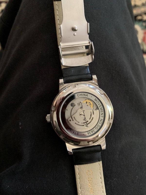 Fancy Automatic watch with clear back bb682307-bdf1-431d-81e0-f4775007ad91
