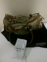 COACH  swaid leather purse with clean kit, and cloth bag to protect it