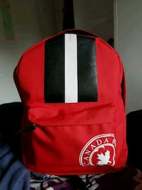 red and black Gucci backpack 1313 km