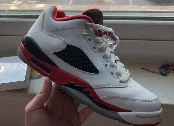 Pair of white-and-red air jordan 5