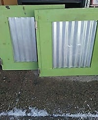 two square green metal window frames