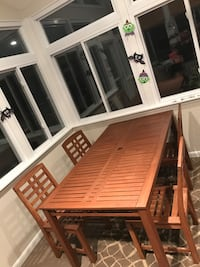 Wood patio table and 5 chairs.