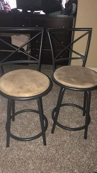 two black metal framed brown padded bar stools Las Vegas, 89115
