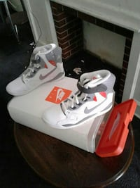 pair of white-and-gray Nike high top sneakers with box