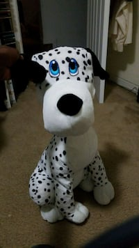 white and black animal plush toy