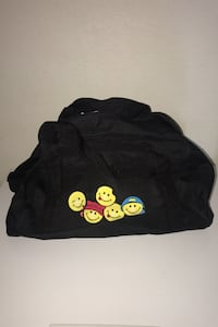 BLACK DUFFLE BAG WITH SMILEY FACES ON FRONT