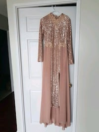 Rose gold long dress with a long tail in the back