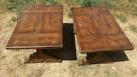 two rectangular brown wooden trestle tables