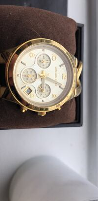 round gold chronograph watch with black leather strap Toronto, M5S 0B7