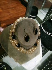 white pearl necklace and pair of hook earrings St. Louis, 63111