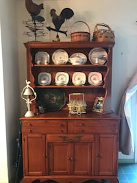Brown wooden hutch with 2 drawers, silverware drawer and storage area
