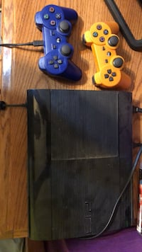 black PlayStation 3 console with 2 controllers 2294 mi