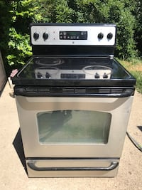 black and silver GE induction range oven Redford