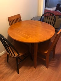 round brown solid wood table with four chairs dining set. Riva, 21140