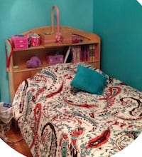 Twin bed with head board shelves and bottom drawers