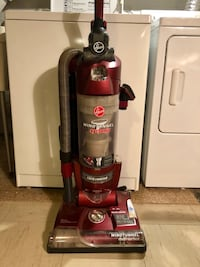 Red and black Hoover upright vacuum cleaner Glen Cove, 11542