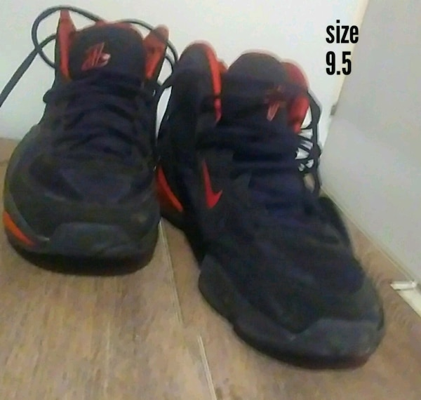 pair of black-and-red Nike basketball shoes
