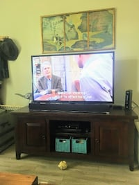 Great condition World Market Media Cabinet. I mounted my TV so no longer needed. Dimensions are 57x22x24. $125 OBO.  Boulder