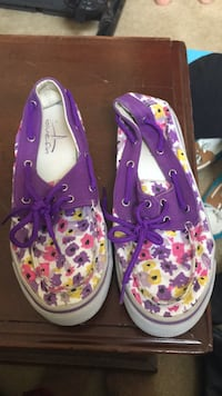 pair of purple-and-pink floral sneakers 46 km