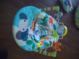 Baby mirror and swinging toys