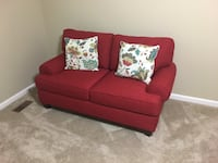 red fabric sofa with throw pillows Charlotte