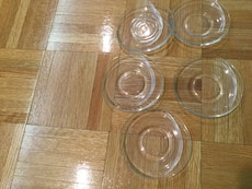 five clear glass plates