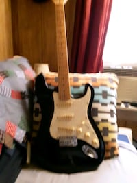 left-handed electric guitar beautiful and stand