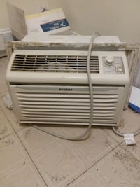 white Haier window type air conditioner