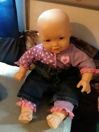 baby in purple heart-print shirt and pants doll