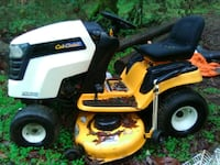 yellow and white Cub Cadet ride-on mower 2326 mi