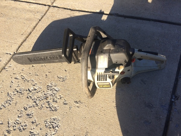 Gray and black poulan chainsaw