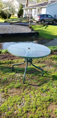 Green metal framed glass top patio table Williamsport, 21795