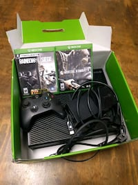 Xbox One console with controller and game cases Knoxville, 37934