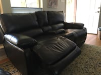Brown leather reclining love seat with center console Austin