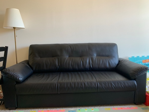Black leather sofa from IKEA