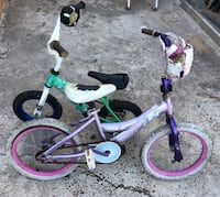 Toddler's purple and white bicycle with training wheels Alamo, 78516