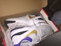pair of white-and-purple Nike shoes with box