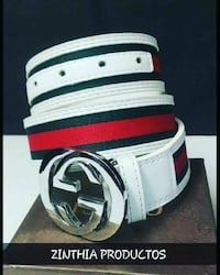 white, black, and red Gucci leather belt
