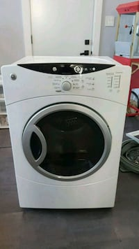 white Whirlpool front-load clothes washer Laval, H7P 4V2