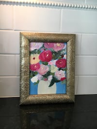 square brass-colored photo frame